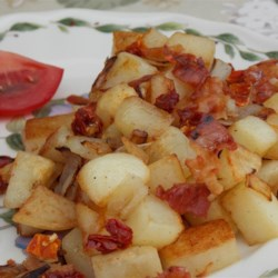Bacon Home Fries Recipe - This recipe cooks diced potatoes, peppers, and onions in bacon drippings for a quick and easy pan-fried potato dish.