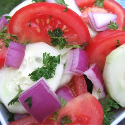Cucumber, Tomato, and Red Onion Salad Recipe - Cucumbers, tomatoes, and red onion are tossed with cilantro and lime juice in this cool and refreshing salad.