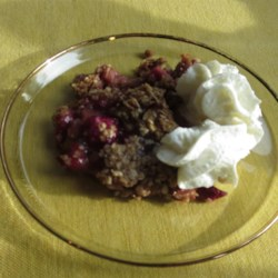 Easy Rhubarb Crisp Recipe - Rhubarb layered between a buttery oat crust and oat crumble topping in this recipe for rhubarb crisp is a great way to use extra rhubarb in the spring.