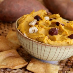 Sweet Potato Hummus Recipe - Hummus with cooked sweet potatoes added to the mix is a colorful and tasty twist on the traditional hummus recipe.