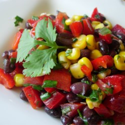 Black Bean and Corn Salad II Recipe - A tasty lime dressing, with cayenne and garlic added for kick, make this salad a bit different from the usual.