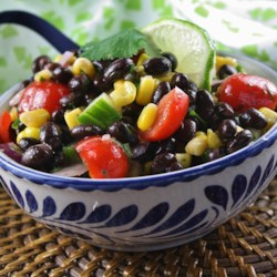 Summer Veggie Salad Recipe - Fresh corn kernels, avocado, black beans, and tomatoes are tossed with lime juice and cilantro creating a refreshing summer vegetable salad.