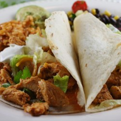 Chicken Taco Filling Recipe - Slow-cooked chicken breasts need only chicken broth and taco seasoning to make a mean taco filling.