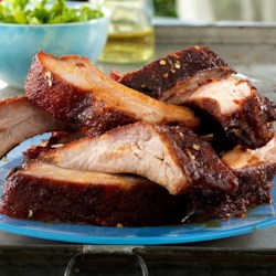 Sweet & Spicy Asian Style BBQ Back Ribs Recipe - The spicy sweetness of the rub is complemented with the fruit and spice notes of the sauce in these delicious Asian-inspired pork back ribs.