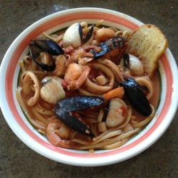 Zuppa Di Pesce Fra Di Avolo Recipe - To fully experience this delicious and spicy Italian seafood and pasta dish, serve with a glass of red wine to the soundtrack of Frank Sinatra.
