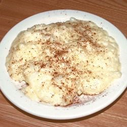 Portuguese Sweet Rice Recipe - Stovetop rice pudding with eggs added at the very end for a rich texture.