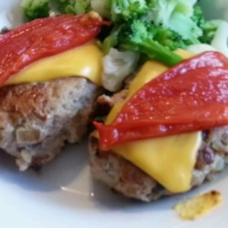 Moist Turkey Burgers Recipe - Chopped whole-wheat bread helps bind ground turkey into burgers flavored with mustard, onion, and garlic in this alternative to beef burgers.
