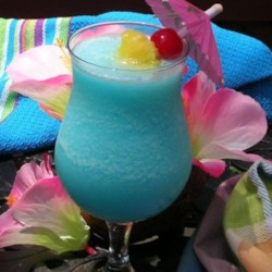 Blue Hawaiian Cocktail Recipe - Invented in Hawaii in the 1950s, the Blue Hawaiian will have you crooning like Elvis.
