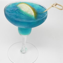 Blue Lagoon Margaritas Recipe - Blend tequila, Blue Curacao, lime juice, pineapple juice, and sour mix together with ice to create this delicious Blue Lagoon margarita.