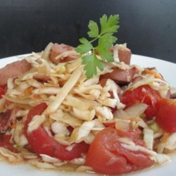 Mom's Polish Stewed Cabbage Recipe - This family hand-me-down recipe is a mixture of cabbage, onion, garlic, tomato, caraway seed, and smoked sausage for a hearty Polish-style meal.