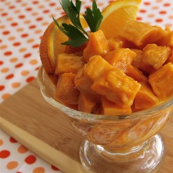 Gingered Sweet Potatoes with Orange Juice Recipe - Use your microwave oven to cook sweet potatoes to then be baked in a thick and buttery orange juice-based sauce with ginger.