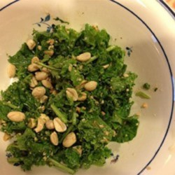 Kale Salad with Peanut Dressing Recipe - This kale salad with cilantro, mint, and peanuts is tossed in a peanut dressing creating a refreshing and hearty meal.