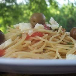 Fettuccini with Salsa Cruda and Feta Recipe - Fresh tomatoes are combined with red onion, fresh basil and kalamata olives, served on a bed of fettuccini,  and topped with feta cheese.