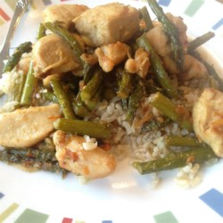 Orange Chicken with Asparagus Recipe - A quick Asian-inspired dish of chicken breasts cooked with asparagus in a sauce flavored with orange juice and zest is just right for a weeknight in spring.