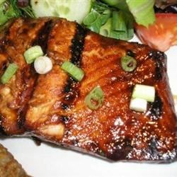 Honey-Ginger Grilled Salmon Recipe - This recipe is simple to make, yet impressive. The spicy, sweet, and salty marinade gives the fish a taste that my family goes nuts for! If it's too cold out to grill it, you also may broil it.