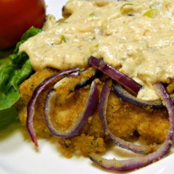 Dreamy Sour Cream and Chive Chicken Recipe - Chicken is breaded, baked with red onion, and topped with a delicious sour cream and chive sauce in this easy weeknight dinner recipe.