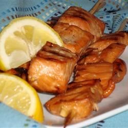 Grilled Salmon Skewers Recipe - Grilled, salmon skewers marinated in honey, soy sauce, and ginger. A delicious appetizer that won't have you missing your own party to prepare.