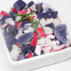 Red, White and Blue Potato Salad Recipe - Purple potatoes and red radishes bring bright colors to this potato salad that also features onion and blue cheese.