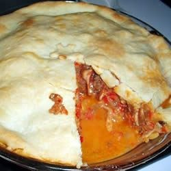Beef and Pepper Pie Recipe - This hearty double-crust pie is filled with a delicious beef mixture that 's simple to make. Sweet red peppers packed in oil are tossed into the blender and then cooked up with ground beef, mushrooms, and cheddar cheese. The pie is then baked until browned and heated through.