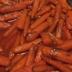 Honey Roasted Carrots with Cumin Recipe - Carrots are tossed with olive oil, cumin, and honey in this simple, easy, and yummy side dish.