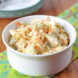 Sweet Restaurant Slaw Recipe and Video - Starting with prepared coleslaw mix this recipe for a creamy coleslaw delivers a bit of tang through the use of vinegar, making it a perfect accompaniment for fried chicken, burgers, or fried fish.