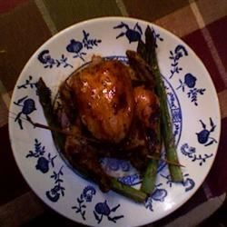 Cornish Hens with Coffee Liqueur Sauce Recipe - Amaze you family and friends with this stunning main dish. Cornish game hens stuffed with fruit and roasted with a coffee liqueur glaze.