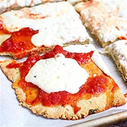 Almond Flour Pizza Crust Recipe - Making gluten-free pizza at home has never been easier. With this recipe we blend together our signature almond and coconuts flours for a thin, crisp crust that will hold up to all of your favorite toppings. Plus, the crust is also yeast-free, and comes together in less than 40 minutes.