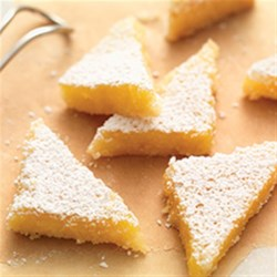 Gluten-Free Lemon Squares with an Almond Flour Crust Recipe - These tangy/sweet squares offer the perfect balance between a slightly nutty, buttery shortbread crust, and bright lemony filling.
