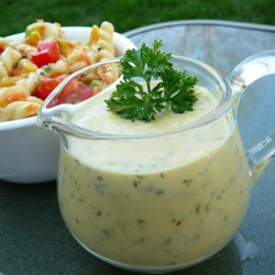 Home-Opener Pasta Salad Dressing Recipe - A quartet of fresh herbs -- basil, oregano, thyme, and parsley -- bring the flavors of summer freshness to this creamy dressing for pasta salad.