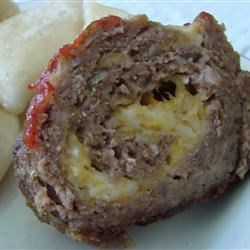 Cheesy Meatloaf Recipe - A 'stuffed' meatloaf made with beef, pork, cheese, eggs, soup mix and bread crumbs.  Mozzarella cheese jazzes up a classic.