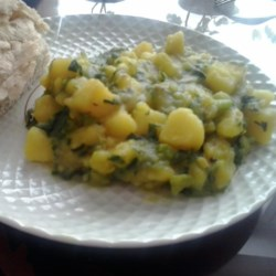 Aloo Palak Recipe - Spinach and potatoes are stir-fried in this simple vegetarian dish from India.