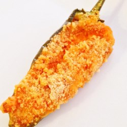 Baked Jalapeno Poppers Recipe - This recipe for a homemade version of a popular restaurant appetizer seasons a cheese filling with taco seasoning and uses bread crumbs to top.