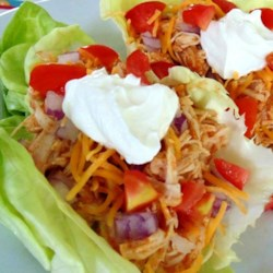 Fiesta Slow Cooker Shredded Chicken Tacos Recipe - Chicken is seasoned with taco seasoning mix and cooked in the slow cooker creating a tasty filling for chicken tacos.