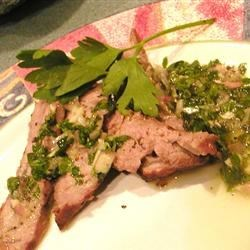 Chimichurri Sauce for Steaks Recipe - Herbs and spices are added to olive oil, sherry vinegar, and lemon juice, then whirred in a blender or food processor. The sauce can be used as a marinade.