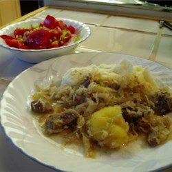 Easy Pork and Sauerkraut Recipe - This is a recipe that is similar to my Pennsylvania Dutch grandmother's but was  modified by me. She used a pressure cooker but I prefer the crock pot. I always serve this with a side of mashed potatoes and applesauce to accompany it.
