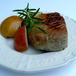 Boneless Pork Chops and Apples Recipe - Boneless pork chops and apples are cooked with rosemary and butter for an easy meal on weeknights that is packed with flavor.