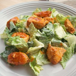 Hot 'n' Spicy Buffalo Chicken Salad Recipe - Crisp salad greens are tossed with hot and spicy Buffalo-style chicken bites and a creamy, blue cheese dressing.