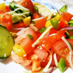 Colorful Tomato Salad with Rose Water Dressing Recipe - Tomatoes, cucumber, and onion are tossed in a light rose water dressing in this refreshing summer tomato salad recipe.