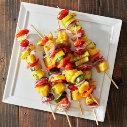 Grilled Fruit and Vegetable Kabobs Recipe - These fresh grilled fruit and veggie kabobs are a great healthy dinner your family will love. Plus, using aluminum foil prevents these kabobs from sticking to the grill, and makes cleanup a breeze.