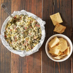 Spinach Artichoke Dip from Reynolds Wrap(R) Recipe - Creamy, cheesy spinach-artichoke dip is baked in Reynolds Wrap(R) Pan Lining Paper for easy clean-up.