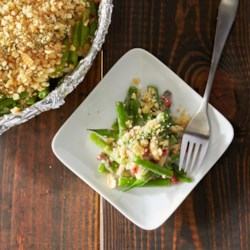 Delightfully Light Green Bean Casserole Recipe - Green bean casserole can get lighter with reduced fat, reduced sodium soup, a cracker onion topper, and some slivered almonds for crunch. Serving casseroles is a cinch when your dish is lined with Reynolds Wrap(R) Pan Lining Paper.