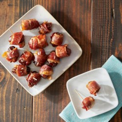 Bacon Wrapped Dates Recipe - The three ingredients that go into this appetizer will fill your kitchen with an irresistible aroma that draws friends and family from all corners of the house. Sweet dates and crunchy smoked almonds get wrapped in salty smoked bacon. Maybe you should make two recipes.
