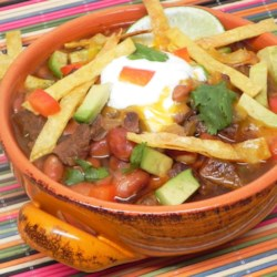 Mexican Chili Soup Recipe - Mexican-inspired chili includes rump roast simmered with green chile peppers, pinto beans, enchilada sauce, and plenty of seasoning for a warm meal served over rice.