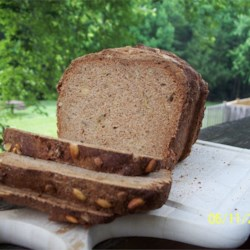 Pumpkin and Sunflower Seed Bread Recipe - This 100% whole wheat bread gets an extra chewy crunch from toasted pumpkin seeds and sunflower seeds.