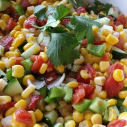 Easy Corn Salad - Great Side for BBQs Recipe - Corn salad with plenty of corn varieties, tomatoes with green chile peppers, and red bell pepper is a quick and easy side dish for picnics or Cinco de Mayo parties.