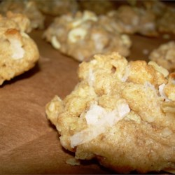 Coconut Oatmeal Cookies II Recipe - This is a variation on a traditional oatmeal cookie. The white chocolate is a delicate touch to a rich, delicious cookie. Enjoy!