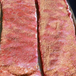 Dry-Rubbed Ribs Recipe - Baby back pork ribs are coated in a dry rub made with chili powder, paprika, and brown sugar creating a very flavorful and easy way to prepare ribs.