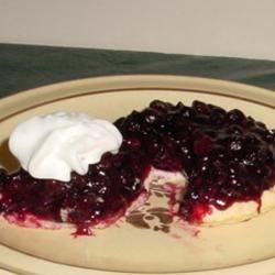 Fresh Blueberry Pie II Recipe - Fresh berries are piled into a pastry shell and topped with sweetened cooked berries flavored with lemon juice. The pie is chilled, and then served with freshly whipped cream.