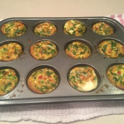 Breakfast Egg Muffins Recipe - Make a week's worth of breakfasts good to grab and go with eggs, spinach, bell peppers, jalapeno peppers, and ham.