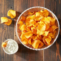 Baked Homemade Sweet Potato Chips Recipe - Served best warm and right out of the oven, sweet potato chips are a simple, wholesome snack your kids will love. Baking on aluminum foil ensures your chips won't get stuck to the baking sheet-and clean up will be fast and easy!